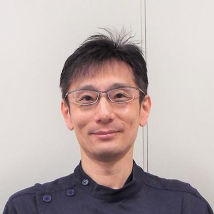 菅 敬治の顔写真